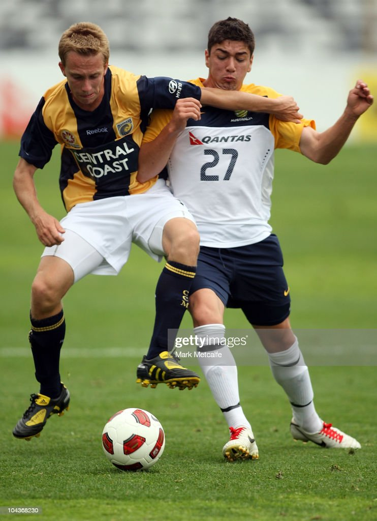 Dimitrios Petratos of the Young Socceroos and Matthew Lewis of the Mariners compete for the ball during the friendly match between the Young Socceroos and the Central Coast Mariners at Bluetongue Stadium on September 23, 2010 in Gosford, Australia.