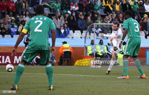 Dimitrios Salpingidis of Greece shoots and scores the equalising goal during the 2010 FIFA World Cup South Africa Group B match between Greece and...