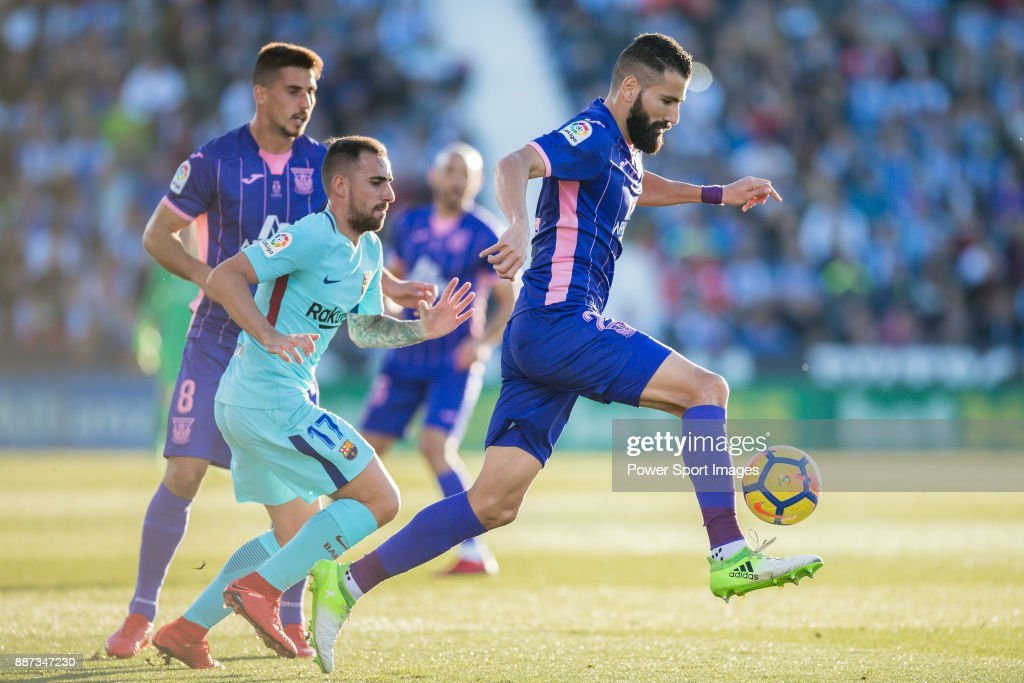 Dimitrios Siovas of CD Leganes (R) fights for the ball with Francisco Alcacer Garcia, Paco Alcacer, of FC Barcelona (L2) during the La Liga 2017-18 match between CD Leganes vs FC Barcelona at Estadio Municipal Butarque on November 18 2017 in Leganes, Spain.