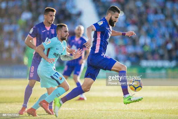 Dimitrios Siovas of CD Leganes fights for the ball with Francisco Alcacer Garcia Paco Alcacer of FC Barcelona during the La Liga 201718 match between...