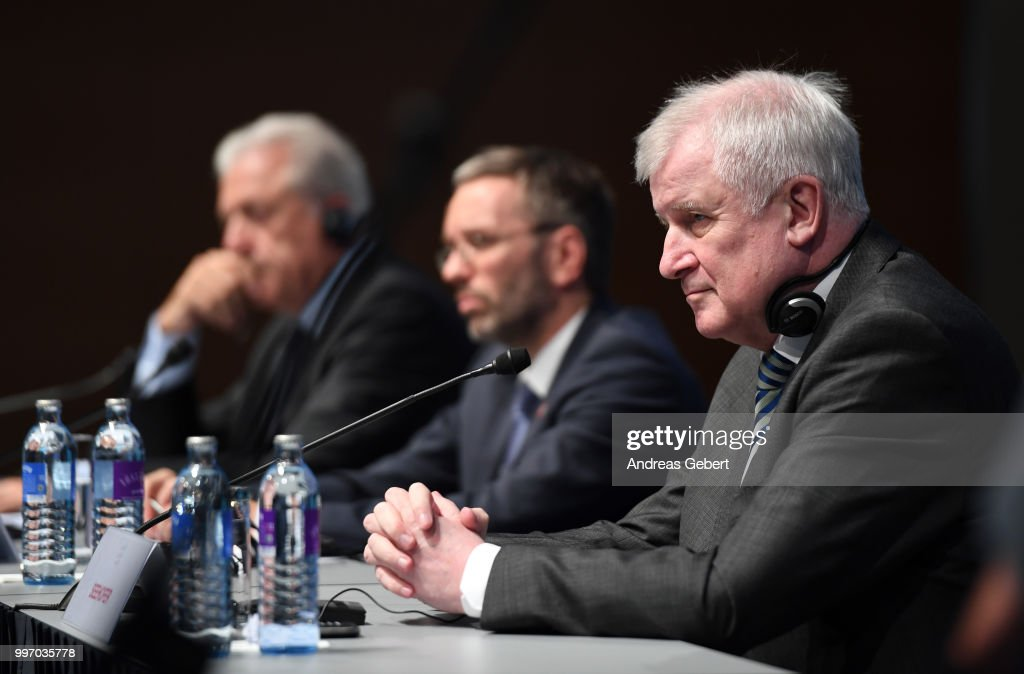 Dimitris Avramopoulos, Commissioner for Migration, Home Affairs and Citizenship of the European Commission, Herbert Kickl, Interior Minister of Austria, and Horst Seehofer, Interior Minister of Germany, speak at a press conference during the European Union member states' interior and justice ministers conference on July 12, 2018 in Innsbruck, Austria. The meeting is taking place among mounting efforts by governments across Europe to restrict the entry of migrants and refugees.