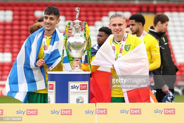 Dimitris Giannoulis and Przemyslaw Placheta of Norwich City pose with the Sky Bet Championship trophy during the Sky Bet Championship match between...