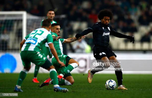 Dimitris Kourbelis of Panathinaikos defends Diego Biseswar of PAOK during the Greece SuperLeague match between Panathinaikos FC and P.A.O.K. At OAKA...