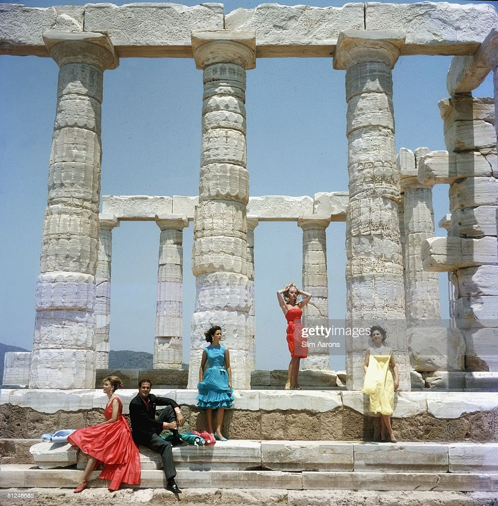 1961, Dimitris Kritsas, a fashionable young couturier, poses among the gleaming Doric columns of the temple to Poseidon at Sounion.