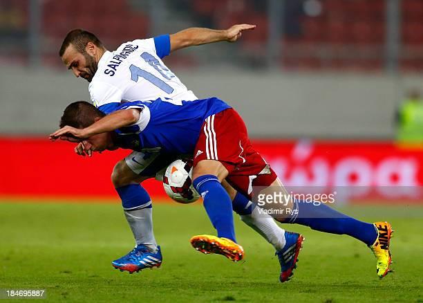 Dimitris Salpigidis of Greece and Sandro Wieser of Liechtenstein battle for the ball during the group G FIFA 2014 World Cup Qualifier match between...