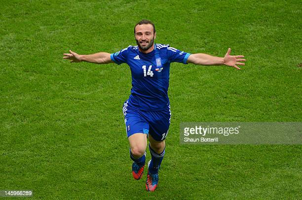 Dimitris Salpigidis of Greece celebrates scoring their first goal during the UEFA EURO 2012 group A match between Poland and Greece at The National...