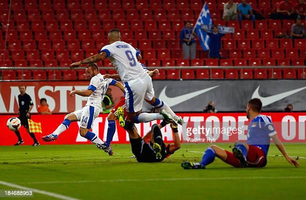 Dimitris Salpigidis of Greece scores his team's first goal during the group G FIFA 2014 World Cup Qualifier match between Greece and Liechtenstein at...