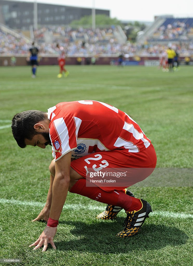 Dimitris Siovas #23 of Olympiacos reacts to an injury during the first half of the International Champions Cup match against the Manchester City on August 2, 2014 at TCF Bank Stadium in Minneapolis, Minnesota. The Olympiacos defeated the Manchester City in a penalty shootout.