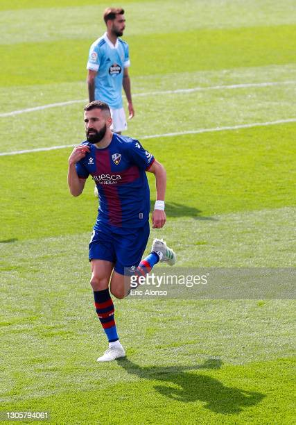 Dimitris Siovas of SD Huesca celebrates after scoring their side's first goal during the La Liga Santander match between SD Huesca and RC Celta at...