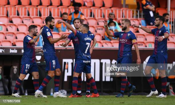 Dimitris Siovas of SD Huesca celebrates with teammates after scoring his team's first goal during the La Liga Santander match between Valencia CF and...