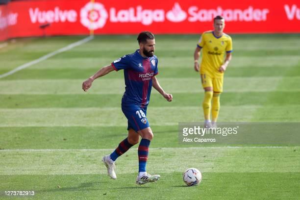 Dimitris Siovas of SD Huesca plays the ball during the La Liga Santander match between SD Huesca and Cadiz CF at Estadio El Alcoraz on September 20...