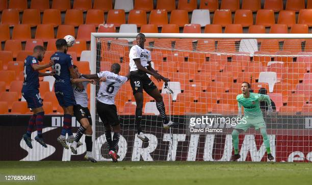 Dimitris Siovas of SD Huesca scores his team's first goal during the La Liga Santander match between Valencia CF and SD Huesca at Estadio Mestalla on...