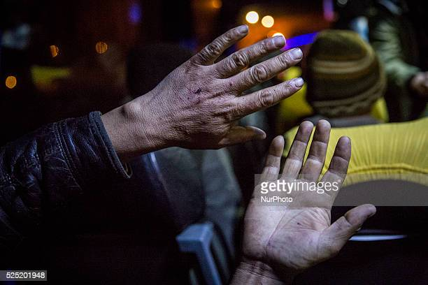 Dimitrovgrad Serbia December 16 2015Abdulmahmud Omarhel had his hands covered with scratches after crossing from Bulgaria to Serbia He and others in...