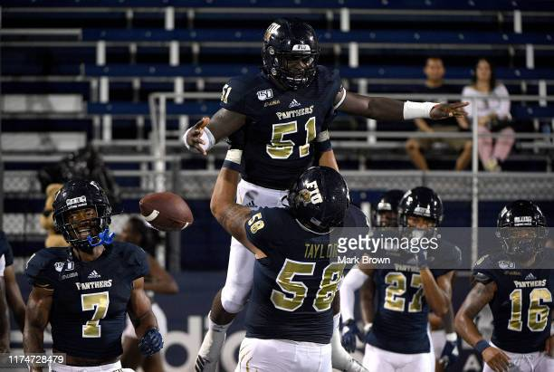Dimitry Prophete of the FIU Golden Panthers celebrates scoring a touchdown in the second half against the New Hampshire Wildcats at Ricardo Silva...