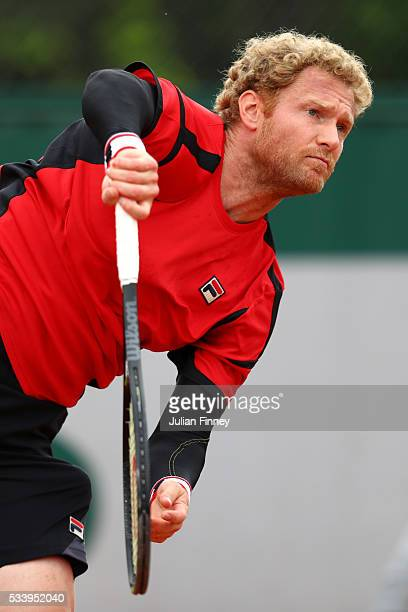 Dimitry Tursunov of Russia serves during the Men's Singles first round match against Roberto Bautistat Agut of Spain on day three of the 2016 French...