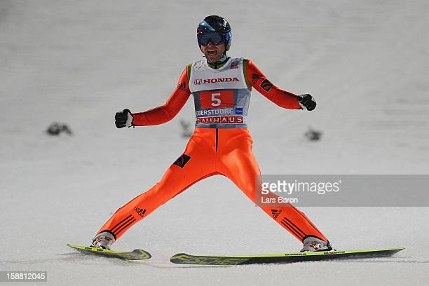 Dimitry Vassiliev of Russia celebrates during the final round second leg for the FIS Ski Jumping World Cup event at the 61st Four Hills ski jumping...