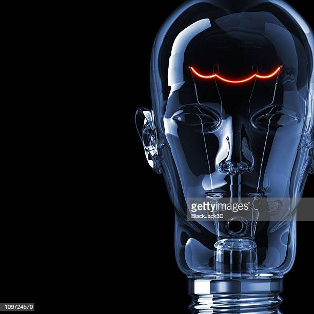 A dimly lit light bulb molded in the shape of a human face