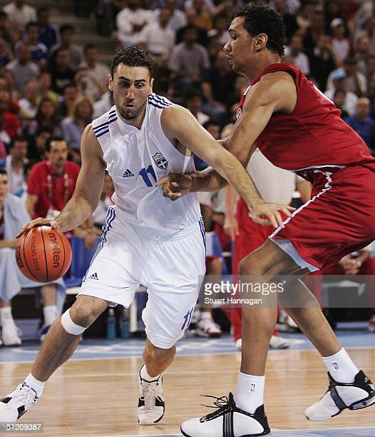 Dimosthenis Ntikoudis of Greece attacks the ball in front of Peter John Ramos of Puerto Rico in the men's basketball preliminary game between Greece...