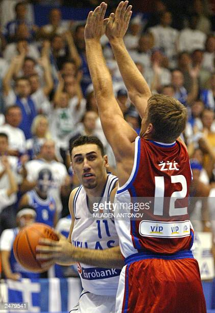Dimosthenis Ntikoudis of Greece tries to hold on to the ball while under pressure from Croatia's Andria Zizic during their match in group D of the...