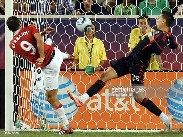 Dimtar Berbatov of Manchester United scores against Geoff Cameron of the MLS AllStars in the second half on July 27 2011 at Red Bull Arena in...