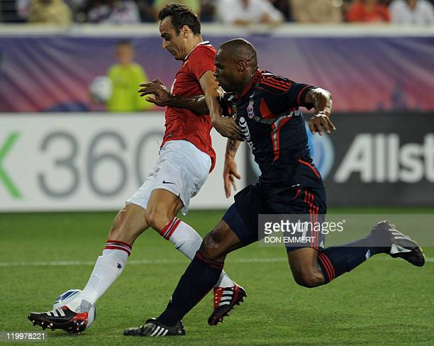 Dimtar Berbatov of Manchester United vies for the ball with Jamison Otave of the MLS AllStars during their friendly match on July 27 2011 at Red Bull...