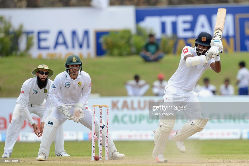 Dimuth Karunarathna (R) Sri Lankan opener playing a shot during day 1 of the 1st Test match between Sri Lanka and South Africa at Galle International Stadium on July 12, 2018 in Galle, Sri Lanka.