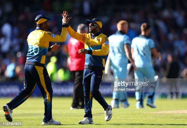Dimuth Karunaratne celebrates with Dhananjaya de Silva after Sri Lanka won by 20 runs during the Group Stage match of the ICC Cricket World Cup 2019...