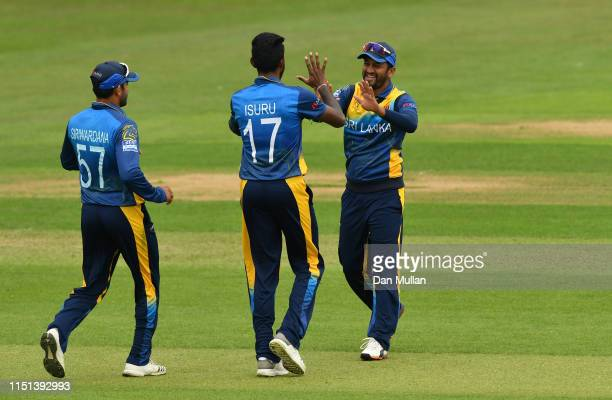 Dimuth Karunaratne of Sri Lanka celebrates with Isuru Udana of Sri Lanka after catching the wicket of David Miller of South Africa during the ICC...