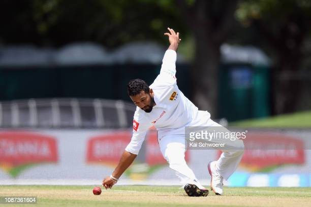 Dimuth Karunaratne of Sri Lanka fields the ball off his own bowling during day three of the Second Test match in the series between New Zealand and...