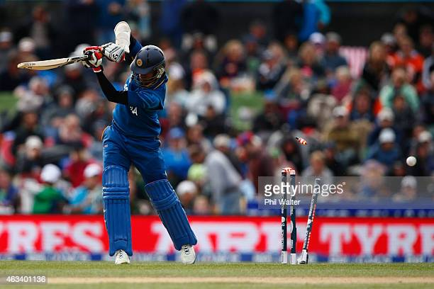 Dimuth Karunaratne of Sri Lanka is bowled by Adam Milne of New Zealand during the 2015 ICC Cricket World Cup match between Sri Lanka and New Zealand...