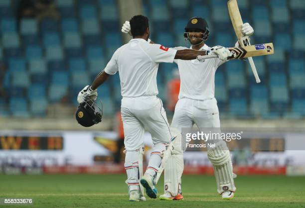 Dimuth Karunaratne of Sri Lanka is congratulated by Dinesh Chandimal of Sri Lanka after reaching his century during Day One of the Second Test...