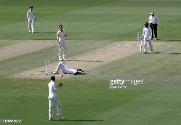 Dimuth Karunaratne of Sri Lanka is struck by a delivery from Pat Cummins of Australia during day two of the Second Test match between Australia and...