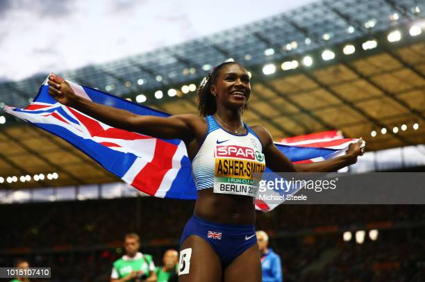 Dina AsherSmith celebrates winning the Gold medal in the Women's 200m Final during day five of the 24th European Athletics Championships at...