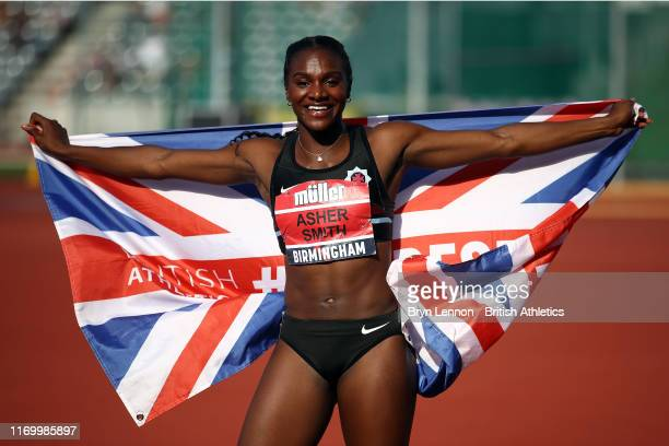 Dina AsherSmith celebrates winning the Women's 100m during Day One of the Muller British Athletics Championships at the at Alexander Stadium on...