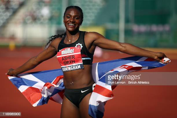 Dina Asher-Smith celebrates winning the Women's 100m during Day One of the Muller British Athletics Championships at the at Alexander Stadium on...