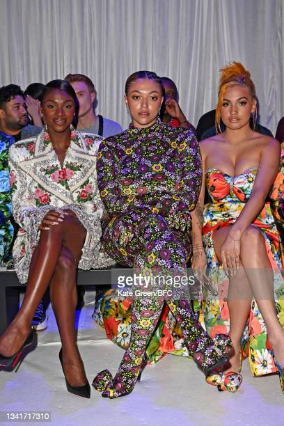 Dina Asher-Smith, Mahalia and Mabel attend the Richard Quinn show during London Fashion Week September 2021 on September 21, 2021 in London, England.