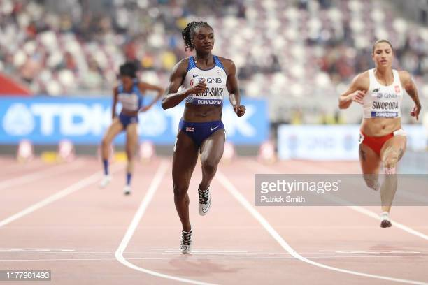 Dina AsherSmith of Great Britain and Ewa Swoboda of Poland compete in the Women's 100 Metres semifinal during day three of 17th IAAF World Athletics...