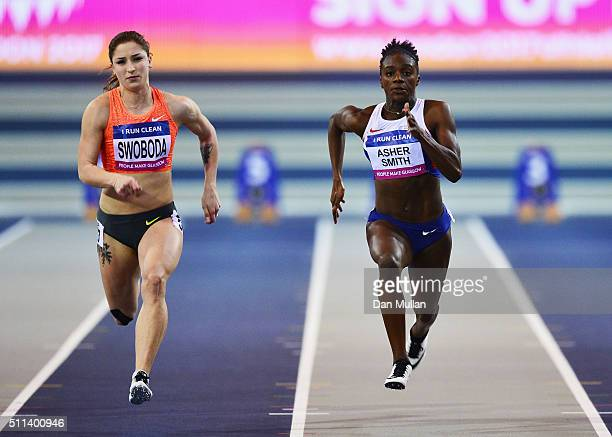 Dina AsherSmith of Great Britain and Ewa Swoboda of Poland compete in the Women's 60 metres heats during the Glasgow Indoor Grand Prix at Emirates...