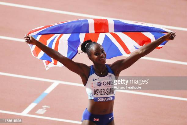 Dina AsherSmith of Great Britain celebrates after winning gold in the Women's 200 metres final during day six of 17th IAAF World Athletics...