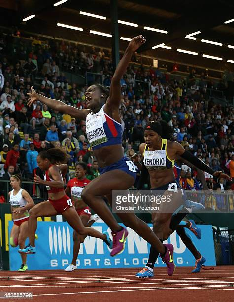 Dina AsherSmith of Great Britain celebrates as she crosses the finish line to win the women's 100m during day two of the IAAF World Junior...