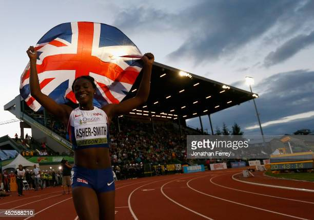 Dina AsherSmith of Great Britain celebrates her win in the 100m Final during day two of the IAAF World Junior Championships at Hayward Field on July...