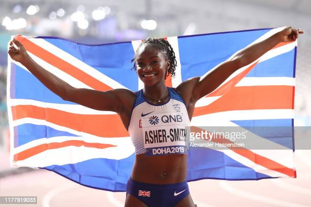 Dina Asher-Smith of Great Britain celebrates silver in the Women's 100 Metres final during day three of 17th IAAF World Athletics Championships Doha...