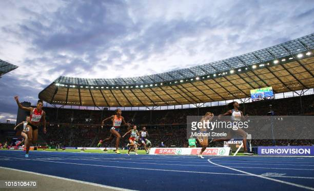 Dina Asher-Smith of Great Britain crosses the line to win gold ahead of Dafne Schippers of the Netherlands competes in the Women's 200 metres final...
