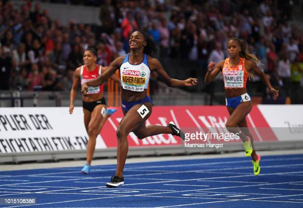 Dina AsherSmith of Great Britain crosses the line to win gold during day five of the 24th European Athletics Championships at Olympiastadion on...