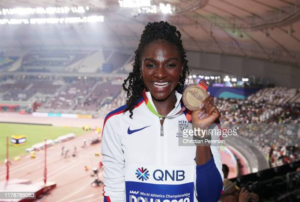 Dina Asher-Smith of Great Britain, gold, poses during the medal ceremony for the Women's 200 Meters during day seven of 17th IAAF World Athletics...