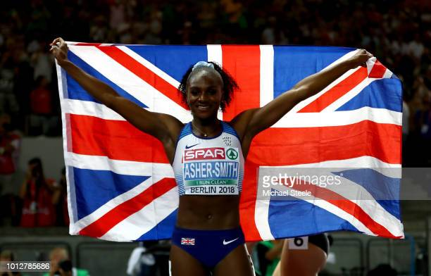 Dina AsherSmith of Great Britain Northern Ireland celebrates winning the gold medal in the Women's 100 meters Final during day one of the 24th...