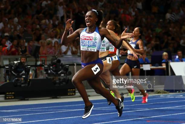 Dina AsherSmith of Great Britain Northern Ireland crosses the line to win the gold medal in the Women's 100 meters Final during day one of the 24th...