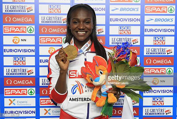 Dina AsherSmith of Great Britain pictured with her Gold medal after winning the Womens 200m Final during day two of the 23rd European Athletics...