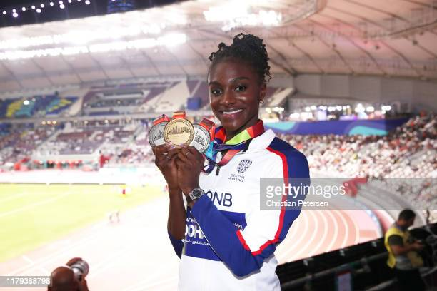Dina AsherSmith of Great Britain poses with her three championship medals during day ten of 17th IAAF World Athletics Championships Doha 2019 at...