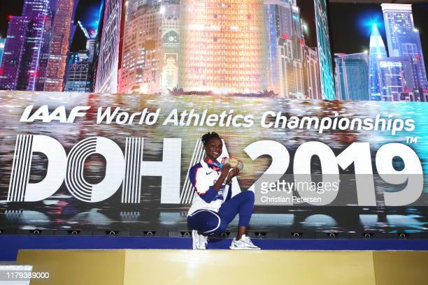 Dina Asher-Smith of Great Britain poses with her three championship medals during day ten of 17th IAAF World Athletics Championships Doha 2019 at...